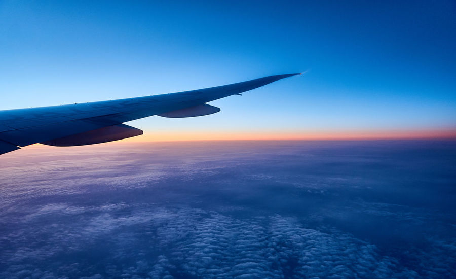 Aerospace Industry Air Vehicle Aircraft In The Sky Aircraft Wing Aircrat Airplane Airplane Wing Arrival Beauty In Nature Blue Business Cloud - Sky Commercial Airplane Day Flying Journey No People Outdoors Private Airplane Sky Sunset Transportation Travel