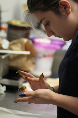 Cakes Dessert Desserts Woman Working Cake Cat Close-up Day Focus On Foreground Food Holding Human Hand Indoors  One Person People Real People Retail  Side View Women Young Adult Young Girl Young Women