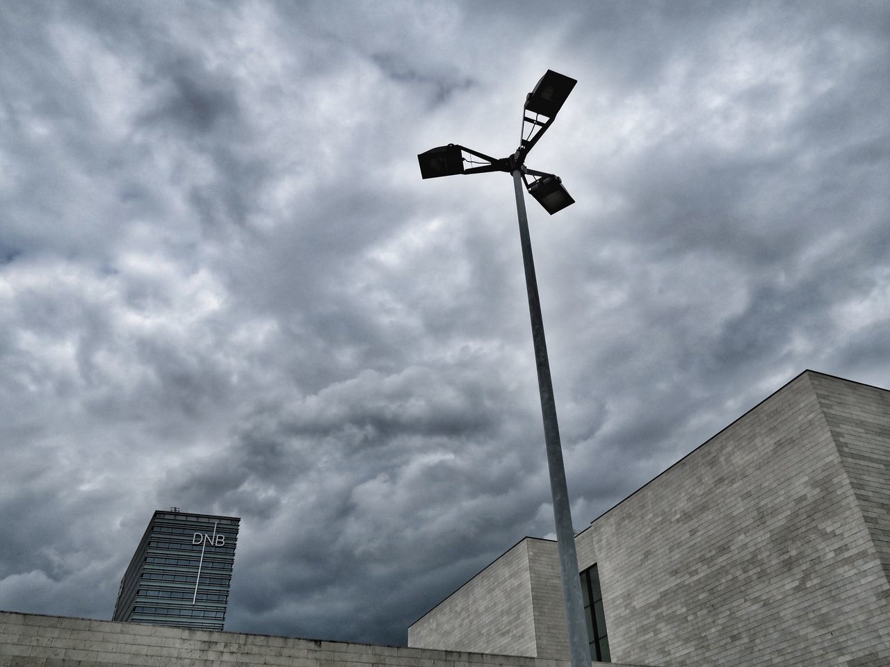 cloud - sky, low angle view, sky, built structure, architecture, building exterior, outdoors, day, no people, storm cloud