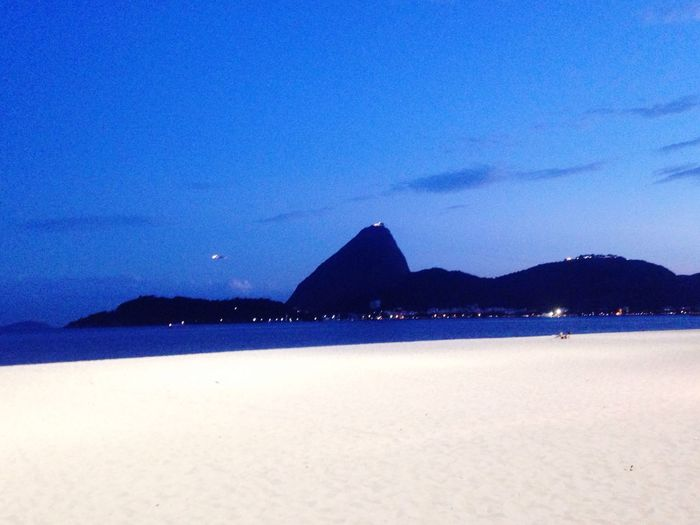 O Rio De Janeiro Continua Lindo 🎶 Blue Water Night Scenics Pão De Açucar Sugar Loaf Nature Mountain Sky Beauty In Nature Tranquil Scene Mountain Range Illuminated No People Outdoors Beach Tranquility Landscape Architecture Contrasts Sand Beach Photography Baia Da Guanabara Blue Sky The Great Outdoors - 2017 EyeEm Awards