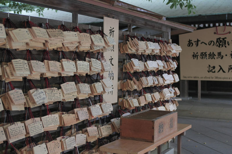 Close-up of fortune papers hanging on railings
