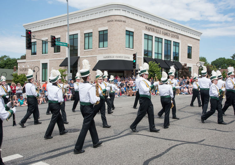 Naperville, Illinois, United States-May 29,2017: Waubonsie Valley High School marching in Memorial Day Parade with crowd in Naperville, Illinois Large Group Of People Crowd Street City March Marching Marching Band High School Students Waubonsie Valley In A Row Architecture Arts Culture And Entertainment Performance Music Turning Feather  Headwear Togetherness Routine Entertainment Musical Instrument Brass Instrument  Teenager Event