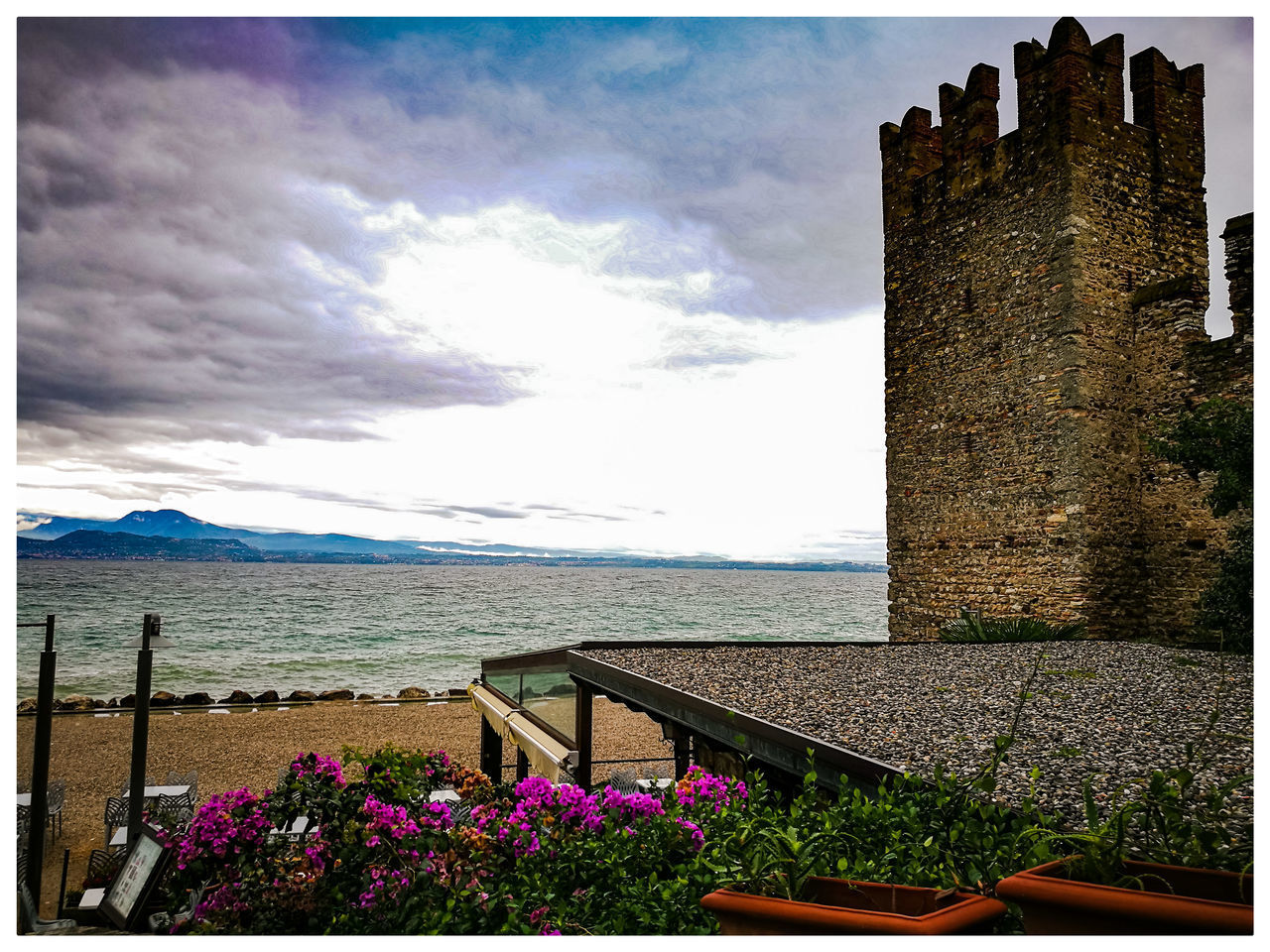 sky, nature, day, built structure, water, beauty in nature, architecture, building exterior, sea, outdoors, flower, history, cloud - sky, scenics, no people, castle, travel destinations, growth
