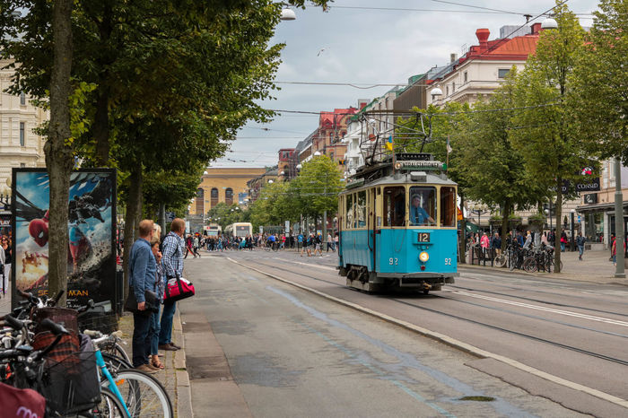 Goteborg Tram Architecture Building Exterior Built Structure City City Life Group Of People Incidental People Land Vehicle Mode Of Transport Old Train Old Transport Public Transportation Railroad Track Real People Road Street Transportation