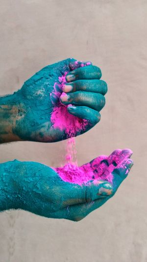 Cropped hands of woman holding powder paints