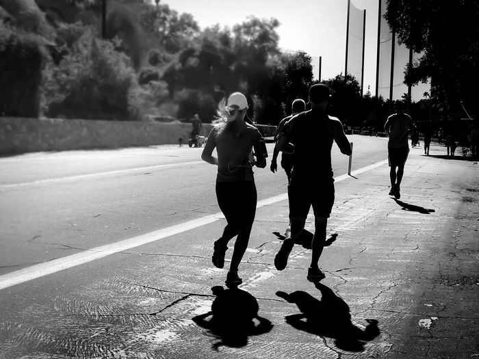 Running.... Lgarciaphoto IPhone 7 Plus IPhone IPhoneography Iphoneonly Shot On IPhone Blackandwhite Black And White Black And White Photography Monochrome Light And Shadow People People Watching Real People Road Full Length Tree Lifestyles Outdoors Men Day Togetherness Teamwork Adult Running