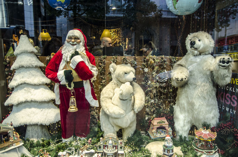 Christmas decorations in a store front in Barcelona Automaton Christmas Christmas Christmas Automaton Christmas Decoration Christmas Market Christmas Store Front Day For Sale Human Representation No People Outdoors Robots Shop Front Statue Store Front Stuffed Toy Teddy Bear