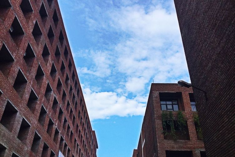 Outdoors Low Angle View Building Exterior Sky No People Architecture Built Structure Low Angle View Cloud - Sky Day