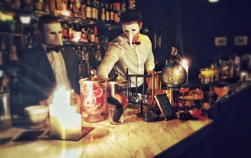 Secret bar Coktail Mixology Venetian Mask Venetian Italy Alchemist Indoors  Halloween Bottle Blacktie Counter Marble Food Stories Adult Indoors  People Bar - Drink Establishment Adults Only Nightclub Drink Bartender Real People Lifestyles Nightlife Illuminated Arts Culture And Entertainment