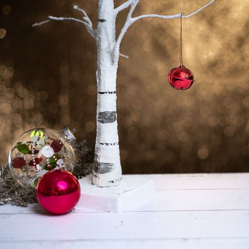Close-up of christmas decorations hanging on tree at home
