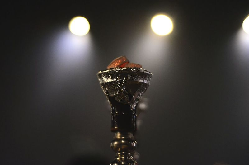 Close-up of hookah against blurred background