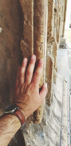 High angle view of man touching hand