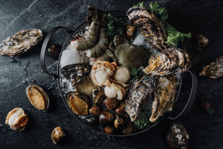 High angle view of various seafood in bowl on table