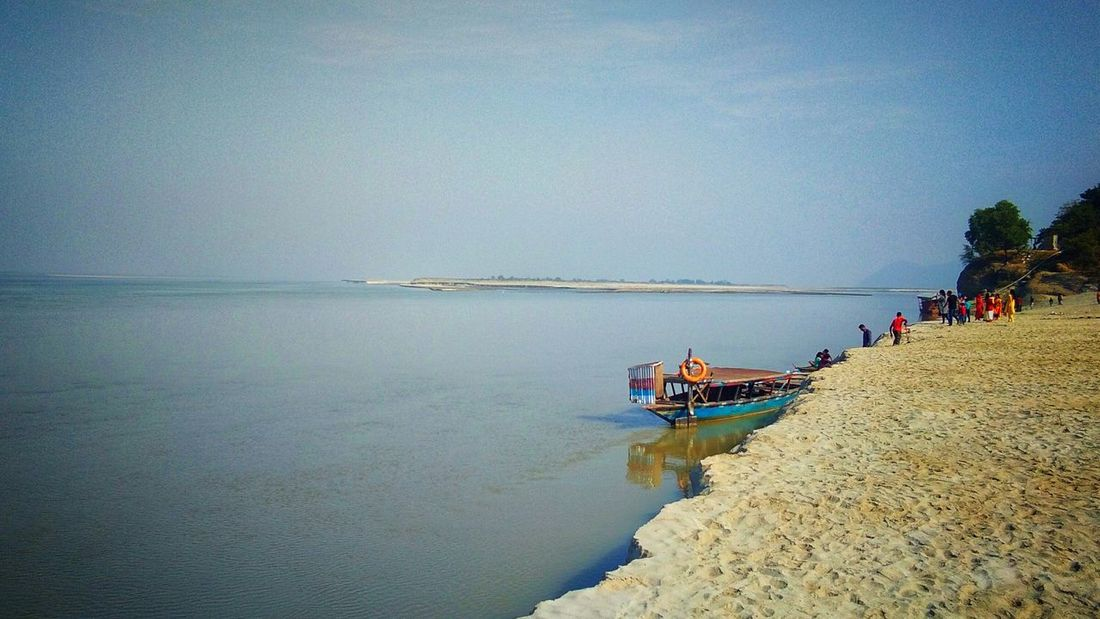Riverside River View The Great Brahmaputra River Brahmaputra_ghat Pride Of North East India Water Sea Blue Sky Built Structure Boat Sailing Boat Calm Sandy Beach Water Vehicle Shore