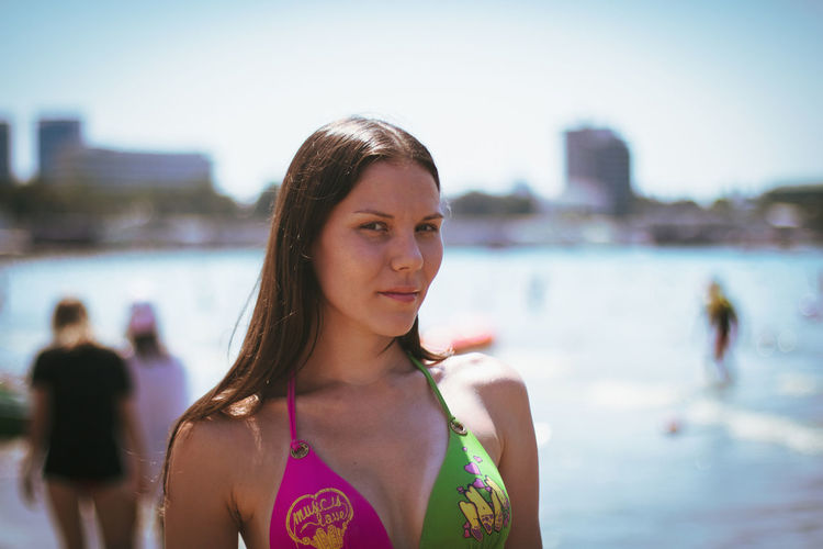 Portrait of woman in bikini top at beach