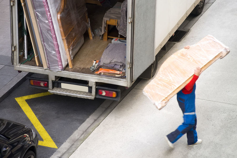 removal truck and delivery man Delivery Delivery Service Service Transport Unrecognizable People Delivery Man Delivery Truck Industry Manual Worker Men Motion Occupation One Person People Professional Real People Removal Removal Truck Transportation Vehicle Unrecognizable Person Working