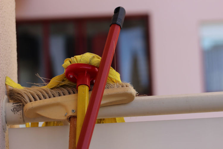 Close-up of yellow working on table