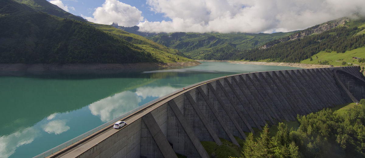 Scenic view of the dam and lake roseland by mountains against sky in the french alpes
