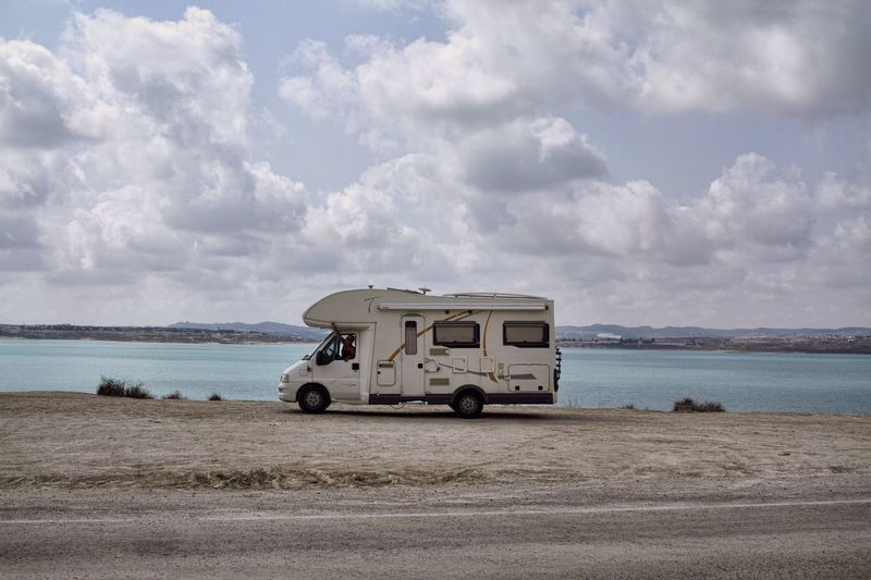 Travel Trailer Against Lake