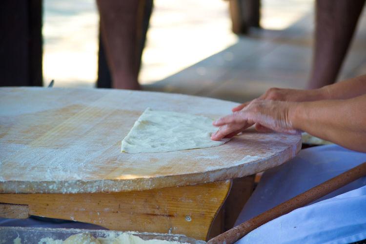 Cropped Hands Of Woman Preparing Food