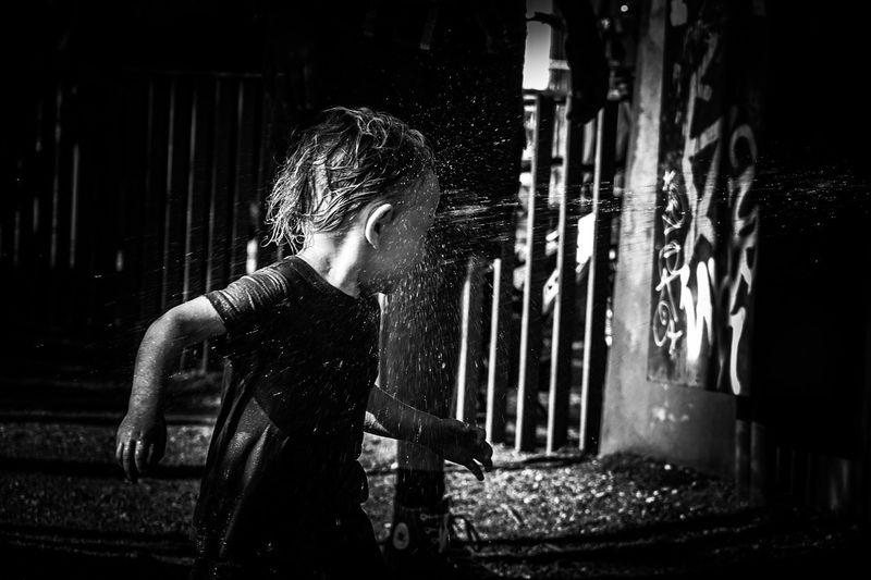 Capture The Moment Children Enjoying Life Wet Water Splashing EyeEm Gallery Monochrome People Photography Motion Close-up Bokeh Street Focus On Foreground Human Face B&w Street Photography New Years Resolutions 2016 Upclose Street Photography