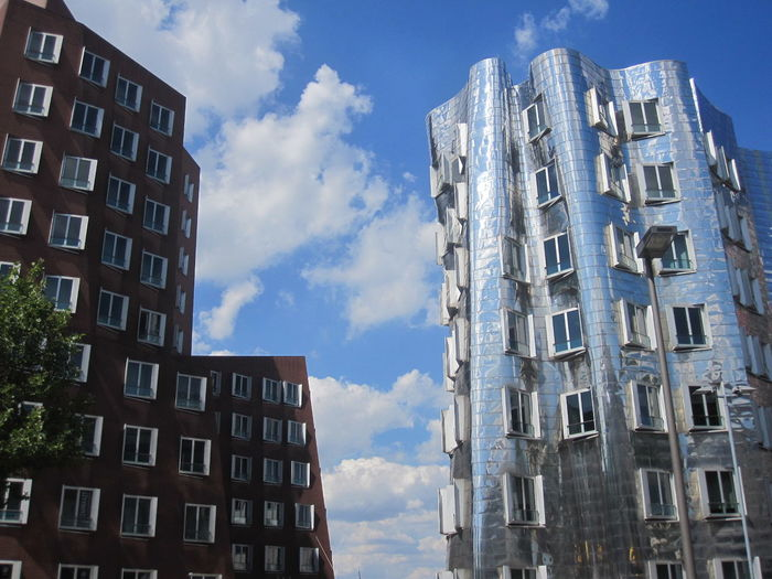 Apartment Architecture Blue Building Building Exterior Built Structure City City Life Cloud Cloud - Sky Cloudy Day Düsseldorf Germany Low Angle View Modern No People Office Building Outdoors Residential Building Residential District Residential Structure Sky Tall - High