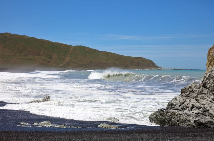 A remote section of coastline on the lower East Coast of the North Island of New Zealand. A seal colony resides at the distant point of land, as well as the rusting hull of a shipwrecked trawler unfortunate to have met stormy seas, having its hull ripped open. The rock to the right of frame is named White Rock, to which the coastline is known as. Beach Beauty In Nature Coastline Motion Nature Natures Beauty New Zealand Landscape New Zealand Scenery Outdoors Sea Seawater Surf Tidal Waves Water Wave