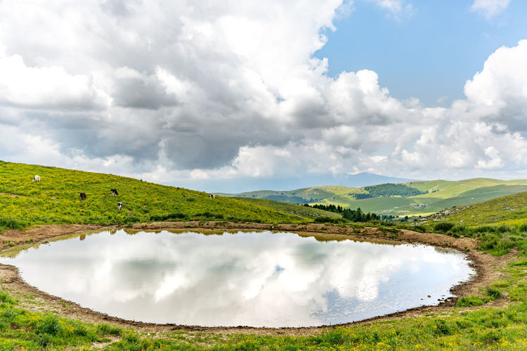 Lessinia mountains and a water pond italian alps