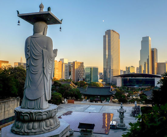 Sunset at Bongeunsa temple of Gangnam District in Seoul City ,South Korea ASIA Background Bongeunsa Buddha Buddishsm Buddhist Building Cityscape District Downtown Architecture City Cityscape Day Outdoors Religion Sculpture Sky Spirituality Sunset
