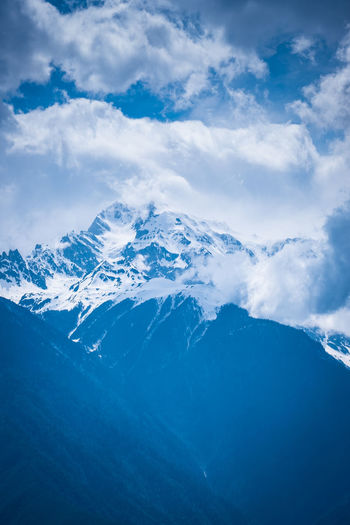 Cloud - Sky Mountain Scenics - Nature Sky Beauty In Nature Cold Temperature Winter Mountain Range Snow Tranquil Scene Tranquility Nature Environment Snowcapped Mountain Landscape Non-urban Scene No People Day Travel Mountain Peak Mountain Ridge Meili DeQin Yunnan China Tibet Fog Cold Cool