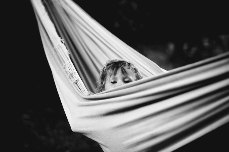 Close-up of child in hammock