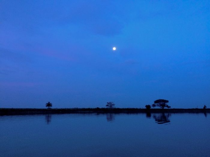 Moon Nature Reflection Sky Beauty In Nature Scenics Silhouette Tranquil Scene Water Tranquility Blue Full Moon Outdoors Night No People Sunset Lake Astronomy Half Moon