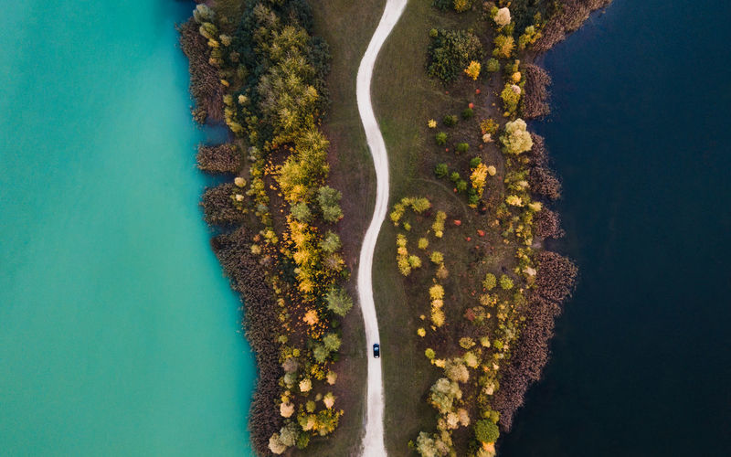 High angle view of road by trees and sea