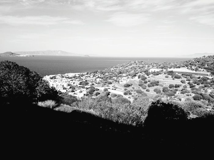 Sea Water Horizon Over Water High Angle View Sky Coastline Tree Scenics Blue Tranquil Scene Mountain Tranquility Architecture City Cityscape Cloud - Sky Beauty In Nature Town Nature Growth Greece Nisyros History Outdoors Monochrome Photography