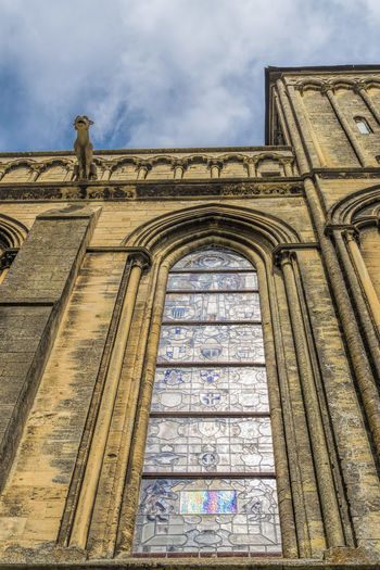 Low angle view of the Catedral of Bayeux in Normandy Ancient Arch Architecture Bayeux Building Exterior Built Structure Cathedral Church Cloud - Sky Day Gargoyle Glass Gothic Historic History Low Angle View Outdoors Place Of Worship Religion Sky Spirituality Window