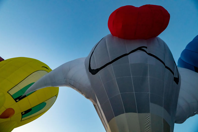 Sky Low Angle View Clear Sky Nature Blue Balloon Day Multi Colored No People Flying Outdoors Yellow Adventure Celebration Close-up Air Vehicle Representation Design Rear View Inflatable