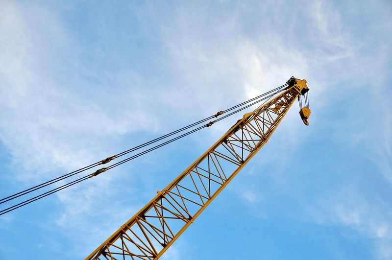 Crane with blue sky Industrial Industry Work Architecture Cloud - Sky Construction Site Contructionwork Crane Crane - Construction Machinery Day Drilling Rig Industry Low Angle View No People No Person Outdoors Sky