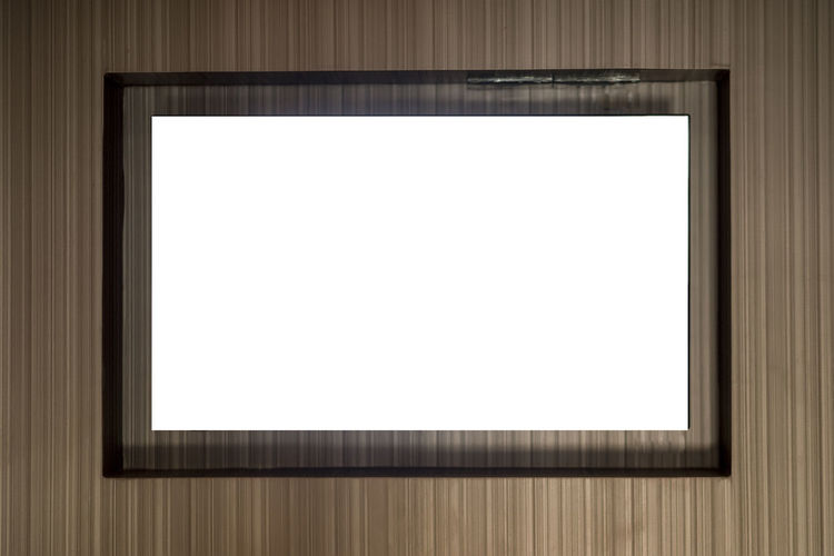 Close-up of blank picture frame on wall