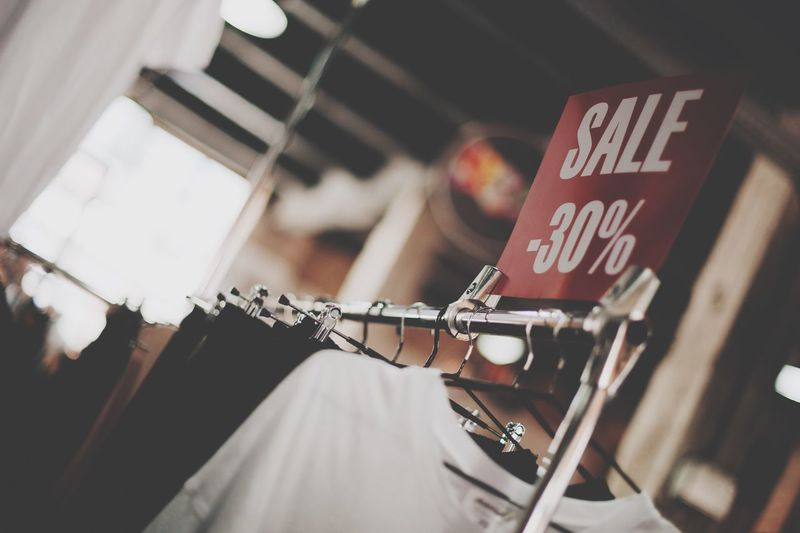 Sale Text Hanging Communication Focus On Foreground Indoors  Western Script No People Script Store Still Life Selective Focus Built Structure Textile Day Low Angle View Sign Close-up Architecture Clothing