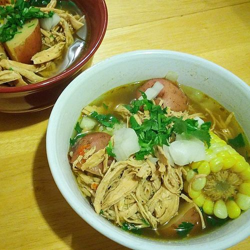 Puertorican Chicken soup with corn on the cob, red potatoes, Puertorican spices(sofrito), rice, topped with onion, cilantro & lime. Even better the second day. Wachacookingame Puertoricansoup Puertoricansoulfood Puertoricanfood