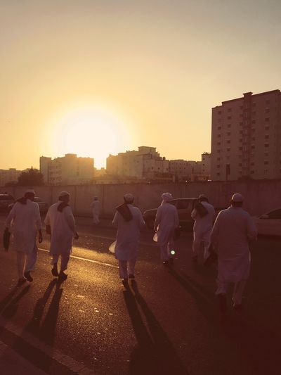 Sunset Real People Building Exterior Architecture Men Built Structure Lifestyles Large Group Of People City Sunlight Outdoors Leisure Activity Women Sky Clear Sky Day Adult People Sunrise Morning Prayer Eid Mubarak Eiduladha