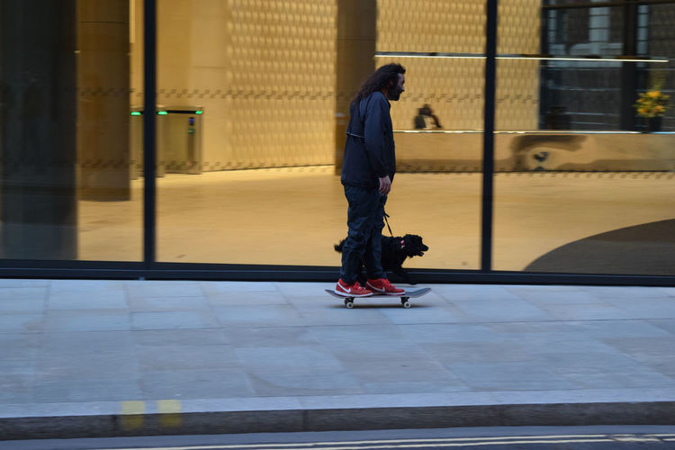Impression London Streets Man And Dog One Person Real People Skateboard Streetlife Streetphotography