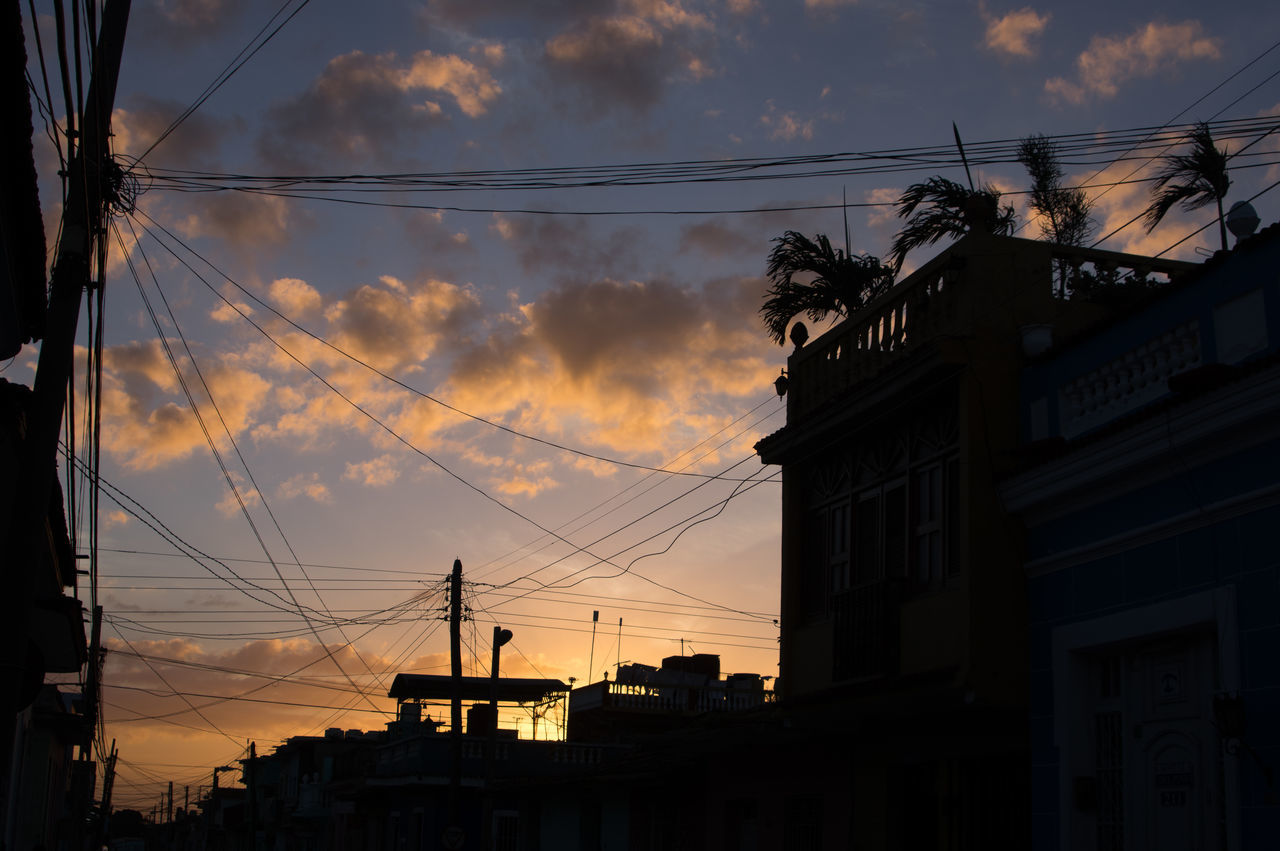 sunset, silhouette, architecture, building exterior, cable, sky, built structure, cloud - sky, connection, outdoors, low angle view, no people, nature, electricity pylon, beauty in nature, city, telephone line, day