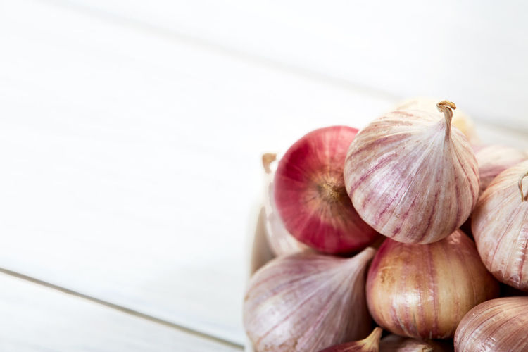 Close-up Copy Space Focus On Foreground Food Food And Drink Freshness Garlic Garlic Bulb Group Of Objects Healthy Eating Indoors  Ingredient No People Onion Purple Raw Food Ripe Spice Still Life Vegetable Wellbeing White Color