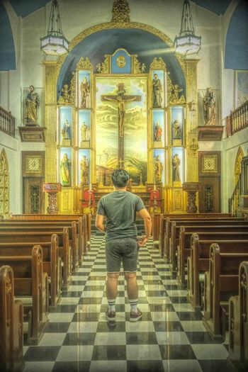 Thy will be doneReligion Rear View Spirituality Indoors  Place Of Worship Travel Destinations Architecture Full Length Altar People One Person Adult Men Back Human Back Day One Man Only Adults Only Architecture Modern
