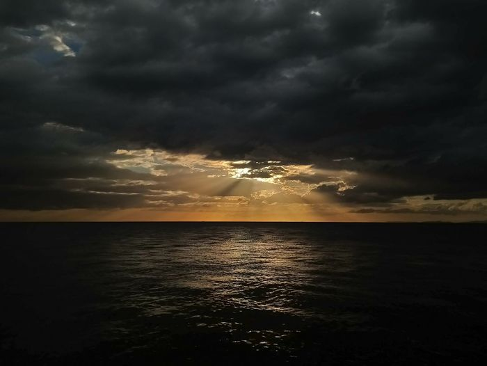 Sun rays Sunset Sea Cloud - Sky Horizon Over Water Beach Water Sky Tranquility No People Scenics Vacations Travel Destinations Outdoors