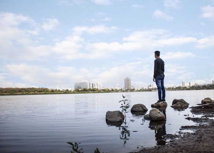Sommergefühle One Person Real People Water Cloud - Sky Full Length Sky Standing Men Day Nature Outdoors Architecture Built Structure Occupation Lifestyles Building Exterior Businessman Beauty In Nature Young Adult One Man Only