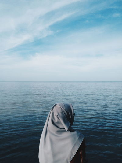 Woman Standing Against Sea