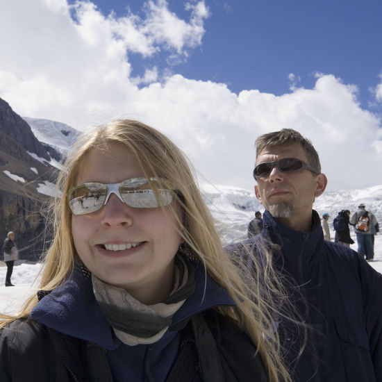 family and mass tourism in the rockies - columbia icefield, jasper national park, canada Athabasca Glacier Blond Hair Canada Cheerful Columbia Icefield Father And Daughter Fun Glacier Happiness Happy Jasper National Park Man Portrait Smiling Snow Snowcapped Mountain Sunglasses Two People Vacations Warm Clothing Winter Winter Winter Sport Woman Young Women