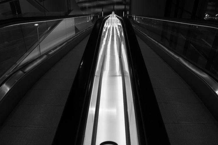 Illuminated escalator at night